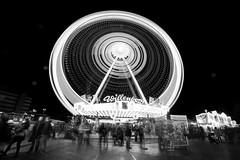 Ferris Wheel at the DOM (virtualwayfarer) Tags: city longexposure nightphotography travel light urban blackandwhite tourism canon germany europe bright dom exploring hamburg streetphotography fair explore german ferriswheel amusementpark streetphoto dslr countyfair blackandwhitephotography 6d northerneurope amusementride northerngermany hamberg hamburgdom cityfair canon6d alexberger virtualwayfarer