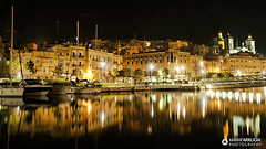 Bormla - Malta (maria farrugia) Tags: trees sea seascape building green church architecture night boats island lights long exposure mediterranean darkness malta dockyard bormla cospicua