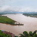 The GOLDEN TRIANGLE- Photo taken from Thailand showing Myanmar (Burma) on the left and Laos on the right.  Mekong River was high due the heavy rains in China