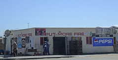 Put more fire (D70) Tags: door lockers lite fire store iron dish satellite security bbq more pepsi barbeque cocacola antenna put amstel namibiaafrica tassenberg wroughr kuisebmondtownship