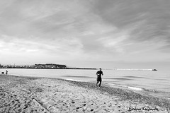 Running on the beach (Eleanna Kounoupa) Tags: sea sky people blackandwhite bw beach clouds landscape sand silhouettes greece crete rethymnon        blackwhitephotos