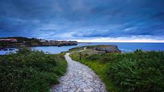 Follow the path... (TanzPanorama) Tags: spain europe europa asturias asturia llanes bay bayofbiscay harbour rocks scenic tanzpanorama sonya7ii sony fe1635mmf4zaoss sel1635z variotessartfe1635mmf4zaoss travel tourism coast seascape path headland sea water landscape puntaradon