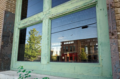 If I could only come 'round once and see your face (fallsroad) Tags: window weathered wood glass reflection sky tulsaoklahoma green paint nikond7000