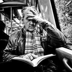 Reading (Per sterlund) Tags: bnw bw baw street streetphotography streetbnw streetbw candid 2016 monochrome mono blackandwhite blackwhite stockholm sweden schweden gatufoto strasenfotografie fotografiadistrada fotografadecalle photographiederue metro tunnelbana iphone book reading read