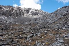 Descent (Vinchel) Tags: china sichuan siguniang trek outdoor mountain hiking fuji xt2 1655mm f28 cliff hill rock formation mountainside landscape travel