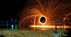 Steel Wool Spinning 1 (Lgh95) Tags: steel wool spinning fire flames spark yellow orange long exposure shutter speed beach pier jetty rails stone dark night time photography portsmouth old hampshire england uk united kingdom hot temperature