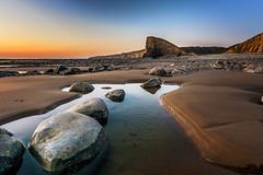 Beach of Boulders (karlmccarthy1969) Tags: beach coast rocks sand sky water glow wales uk