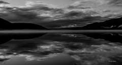 Sound of silence (Jim Skarli) Tags: mountain water lake landscape seascape serene scandinavia norway norge shadows fog mist night bw blackandwhite mono monochrome mood nature natur outdoors reflection