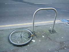 Manchester - i should  have secured it to the frame !!! (rossendale2016) Tags: tread rubber pumped tyres rims front back bicycle cycle hub spokes secure roadside thief stolen frame device mancheater bike rack wheel lock safety security street