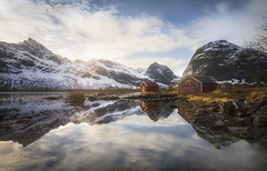 Les Cabanes du Selfjord (jonathan le borgne) Tags: mountain house woodhouse water sea ocean reflection sky clouds light red blue rocks nature landscape waterscape norway lofoten snow sun winter mirror