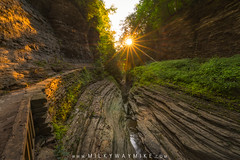 Watkins Glen Sunburst (Mike Ver Sprill - Milky Way Mike) Tags: wakinsglensunburst sunrise sunstar watkins glen falls enlightenment michael ver sprill mike versprill milky way mv nikon d800 state park river stream moss silky smooth soothe soul mine peaceful calm tranquility tranquil amazing beautiful leaves changing autumn fall rocks water motion blur mossy ny new york upstate travel explore landscape foliage waterfall outdoor serene morning reflections reflect creek