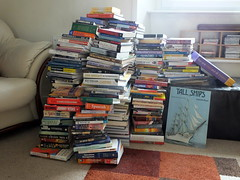 Indoor tasks.... all my books in a heap... three piles needed... keep, read and charity shop... (Sue - happy sparrow) Tags: lounge books livingroom indoors library chair portland dorset