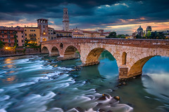 Verona. (Rudi1976) Tags: verona italy pontepietra cityscape italianculture sunset bridge city urbanscene river church veneto saturatedcolor architecture twilight urbanskyline tower famousplace cathedral traveldestinations adigeriver reflection europe southerneurope buildingexterior summer medieval outdoors downtowndistrict street sky dusk brick stone outdoor