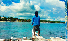 Approaching (free3yourmind) Tags: blue sea man green water island boat philippines captain bohol approach