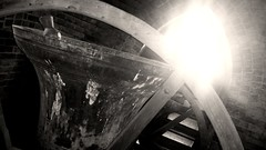 In the belltower (Mooching About) Tags: uk blackandwhite sun dusty church shine bell creepy spooky spire cobwebs creaking