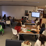 Students learn how to do research in the library.