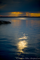 Cloudy sunset by the river (Classicpixel (Eric Galton) Photography Portfolio) Tags: sunset clouds reflection coucherdesoleil nuages water eau river rivire storm tempte ray rayon ottawa ontario canada nikon 28mmf18g ericgalton classicpixel orange landscape seascape paysage