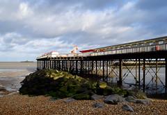 Winter sunshine, Herne Bay pier (Aliy) Tags: sea seaweed beach coast pier kent seaside rocks stones pebbles huts hut beachhut beachhuts helterskelter hernebay greenrocks