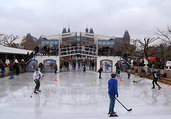Ice hockey on the Museumplein (Bn) Tags: city travel blue winter holiday cold holland ice hockey netherlands amsterdam weather museum kids pancakes season children square fun happy soup museumplein chair topf50 iamsterdam legs body iceskating air skating center newyear canals entertainment national enjoy skate mind rink quarter puck wonderland rijksmuseum stretching ijsbaan pleasure delightful refresh koek 50faves i zopie schaatsclub httpwwwiceamsterdamnl