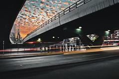 Atardecer bajo Apoquindo (Juan Cristobal Lara) Tags: chile santiago sunset light lights lighttrails lightrails magichour clouds city cityscape people atardecer trafico traffic bridge puente airelibre arquitectura architecture