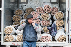 Khiva market - discussing the price of potatoes (10b travelling) Tags: 10btravelling 2015 asia asien carstentenbrink centralasia dishonqala genericplaces iptcbasic ichonqala khiva otherkeywords polvondarvoza silkroad sovietunion ussr uzbek uzbekistan xiva east gate market mna mobile phone potatoes price talking tenbrink thestans tuck veg vegetables