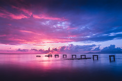 Tahitian sky with an old pier (Sara Fournier) Tags: skies sky ciel rouge flamboyant ponton pier infire fire fireinthesky tahiti tahitian sea ocean pacific poselongue colors filter filtrend nd canon canon6d beach plage polynsiefranaise frenchpolynesia