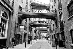 Unabridged (Douguerreotype) Tags: uk gb britain british england london bw blackandwhite mono monochrome street people architecture buildings bridge bridges historic brick