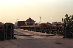 Dusk on the Truss Bridge... (Sheikh Shahriar Ahmed) Tags: film analog nikonfm10 fujifilm dhaka bangladesh banasree af50mmf18d fujicolorc200 dhakadivision aftabnagar epsonv330 sheikhshahriarahmed