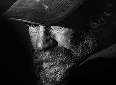 Face - exploring emotions #01 (Ales Dusa. Thanks for faves and comments) Tags: street city portrait urban man art face hat canon beard dof emotion outdoor expression surreal streetportrait streetlife beggar document fullframe baseballcap goldcollection