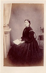 (EastMarple1) Tags: portrait woman plant fashion studio book chair pattern curtain fulllength backdrop cdv 1860s seated
