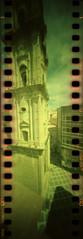 bell tower (pho-Tony) Tags: camera film 35mm xpro crossprocessed fuji cross slide panoramic ishootfilm holes pinhole velvia homemade analogue domino 50 expired processed e6 malaga estenopeica sprocket stenope fujivelvia c41 homemadecamera 23mm filmisnotdead pinholecameras tetenal f99 estenopo dominocam dominopinhole