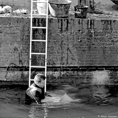 What to do when there's too much water in the canal... (Akbar Simonse) Tags: street people bw man holland blancoynegro water netherlands monochrome square canal bucket zwartwit candid nederland streetphotography denhaag bn ladder haag thehague gracht emmer vierkant lahaye sgravenhage agga straatfotografie akbarsimonse dscn8413