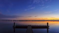 Symmetry (pixadeleon) Tags: wood longexposure blue sky orange lake water yellow sunrise jetty zurich bluehour zrich maur greifensee fllanden challengegamewinner fotocompetitionbronze