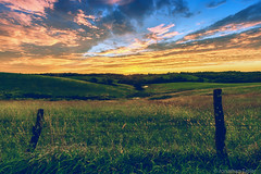 Platte County Sunset (Jonathan Tasler) Tags: sunset missouri plattecounty fence colorful rural farm clouds