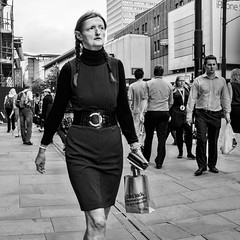 Manchester 035 (Peter.Bartlett) Tags: manchester bag noiretblanc olympusomdem5 unitedkingdom people city urbanarte lunaphoto woman urban walking monochrome uk m43 microfourthirds square bw streetphotography macphuntonality blackandwhite peterbartlett candid england gb