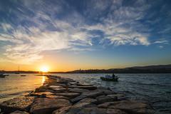 paseo al amanecer (jopas2800) Tags: dawn rocks beach sea ship boats clouds spain nikond610 orange