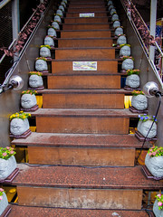 Ikebukuro bars have funny welcome setup (isobrown) Tags: tokyo ikebukuro japan japon stair stairs escalier statuettes heads statue numerous olmeca tequila