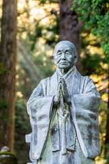 Immortal Monk (phikapphil) Tags: okunoin cemetery mount koya mt koyasan buddhism temple statue monk buddhist japan japanese forest outdoor tree lightbeam praying nikon d7100