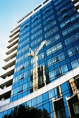 Reflecting on City Construction (thomas100) Tags: olympus xa3 kodak ektar 100 london vauxhall reflection crane building construction