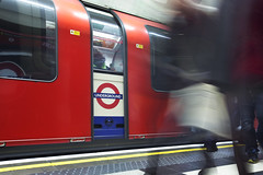 Going underground (Sean Hartwell Photography) Tags: london londonunderground undeground passengers movement people ghost figures trainstation train tube holborn centralline red blue