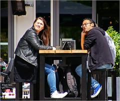 It Must Be Somewhere ... (Hindrik S) Tags: looking up sjen zien kijken people sitting table cafe jeans girl man boy minsken mensen menschen summer simmer terras terrace candid sonyphotographing sony sonyalpha a57 α57 slta57 tamronaf16300mmf3563dillvcpzdmacrob016 street strjitte straat straatfotografie streetphotography