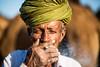 The Herder (Karthikeyan.chinna) Tags: karthikeyan chinnathamby chinna canon canon5d portrait people travel india rajasthan pushkar camel mela smoking cwc chennaiweekendclickers travelwalk old age man closeup
