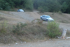 A BMW comes down carefully, making scraping sounds as it descends (oldandsolo) Tags: georgia formerrussianterritory kakhetiregion sionilake sioniwaterreservoir touristspot freshwaterlake watersupply shore daytrippers steep incline slope picnicspot descent car automobile bmwcar