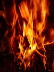 Let the Flames Embrace You (Steve Taylor (Photography)) Tags: flame fire fireplace brown black yellow orange red monocolour monocolor brick wood timber newzealand nz southisland canterbury christchurch hot heat log flames