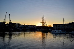 Sunset behind Kaskelot (lizfy30) Tags: bristol docks cranes lloyds kaskelot tall ship barque sundown glow reflection sunset weathervane mast boat nikon d5500 plane trails