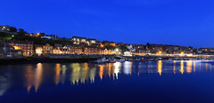 whitby North Yorkshire, (chrissmithphotos1) Tags: ocean street blue light sunset sea england sky house seascape art tourism water beautiful abbey architecture landscape outside evening coast harbor pier boat town seaside colorful long exposure looking rooftops harbour top ripple gorgeous postcard yorkshire north scenic tranquility down landmark calm architectural retro coastal whitby railings leading tranquil attraction longexposureoutdoor