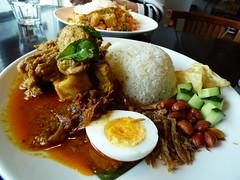 Malaysian nasi lemak (Sandy Austin) Tags: newzealand food fish rice cucumber auckland northshore northisland spicy malaysian takapuna nasilemak krupuk chickencurry sprats sandyaustin panasoniclumixdmcfz70 onionsambol karavadu