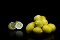 DSC_8832 - The scent of fresh lemons (pucherico) Tags: longexposure lightpainting black beauty yellow fruit dark lemon key natural fav50 low fresh lemons health lowkey scent freshness fav10 fav25 fav75