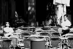 Diagonal look. (Giangaleazzo) Tags: street glass monochrome bar canon germany eos blackwhite chair europe noir drink diagonal aachen rest fotografia vita aquisgrana cameriere 40d lifeinthestreets