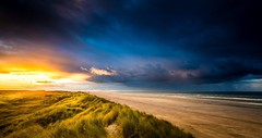 Ameland Sunset (Jacco van der Zwan) Tags: rain clouds sun sea sky beach sunset ameland